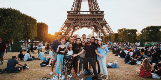 People in front of the Eiffel Tower.